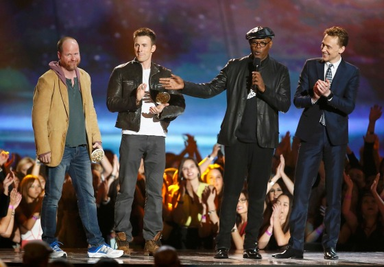 Samuel L. Jackson accepts the award for best fight with Joss Whedon, Chris Evans and Tom Hiddleston at the 2013 MTV Movie Awards in Culver City, California